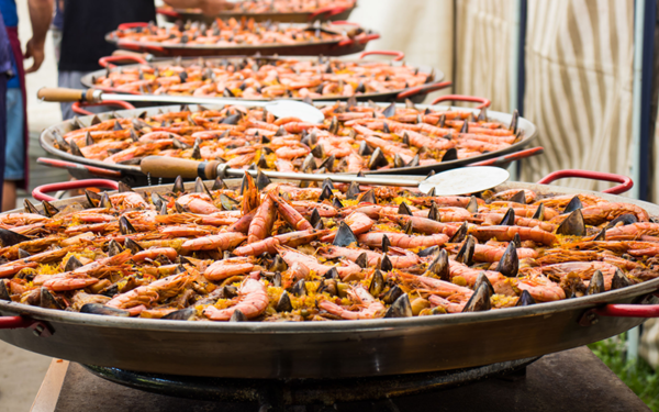 big paella pans cooking spanish rice in sydney